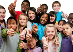 Group of children with thumbs up